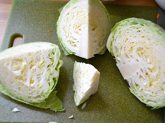 cabbage cut into chunks ready to be shredded