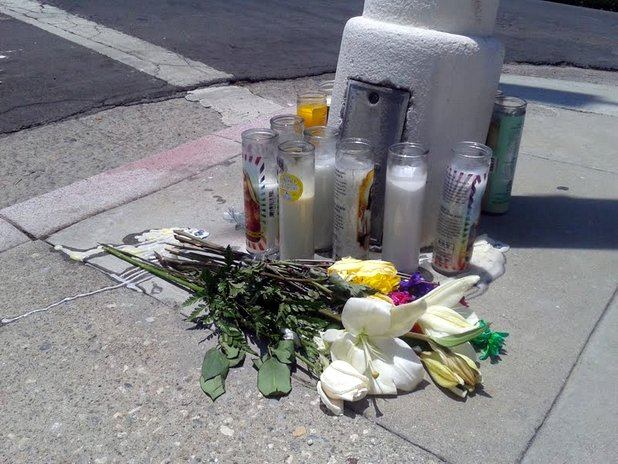 Flowers and candles near Echo Park stabbing scene