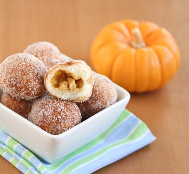 photo of donut holes with one with a bite out of it to show the filling