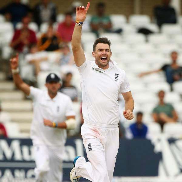 England's James Anderson (R) celebrates after taking the wicket of India's Ravindra Jadeja on the final day of the first cricket Test match between England and India at Trent Bridge in Nottingham, central England on July 13, 2014.