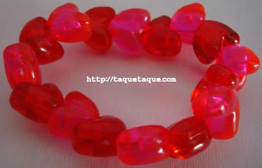 pulsera de corazones transparentes rojos y rosas