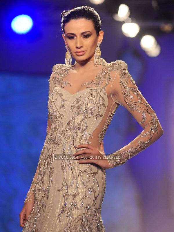 Pia Trivedi walks the ramp for designer Gaurab Gupta on Day 3 of India Couture Week, 2014, held at Taj Palace hotel, New Delhi.<br />