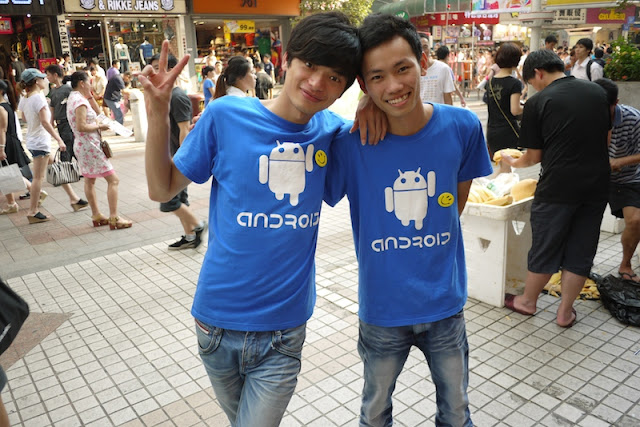 two employees wearing Android shirts in Shenzhen, China