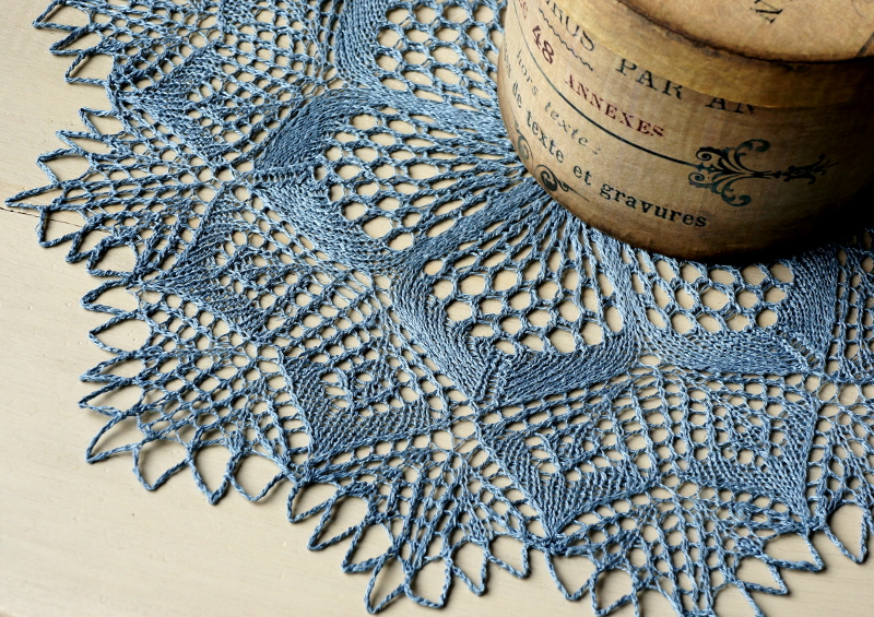 Blue round knitted doily