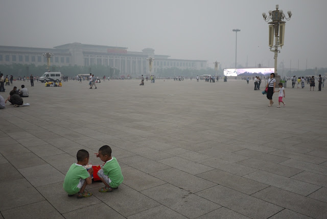 twin boys squatting at Tiananmen Square