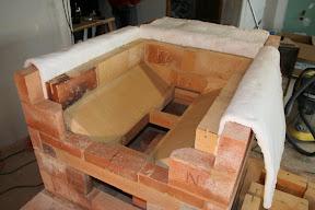 Poêle de masse maçonné en briques réfracataires