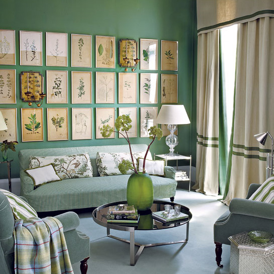 This Pretty Room In All Its Green Glory By House And Home Chooses The Sofa Wall To Display A Collection Of Botanical Printslove How It Warms Up Space