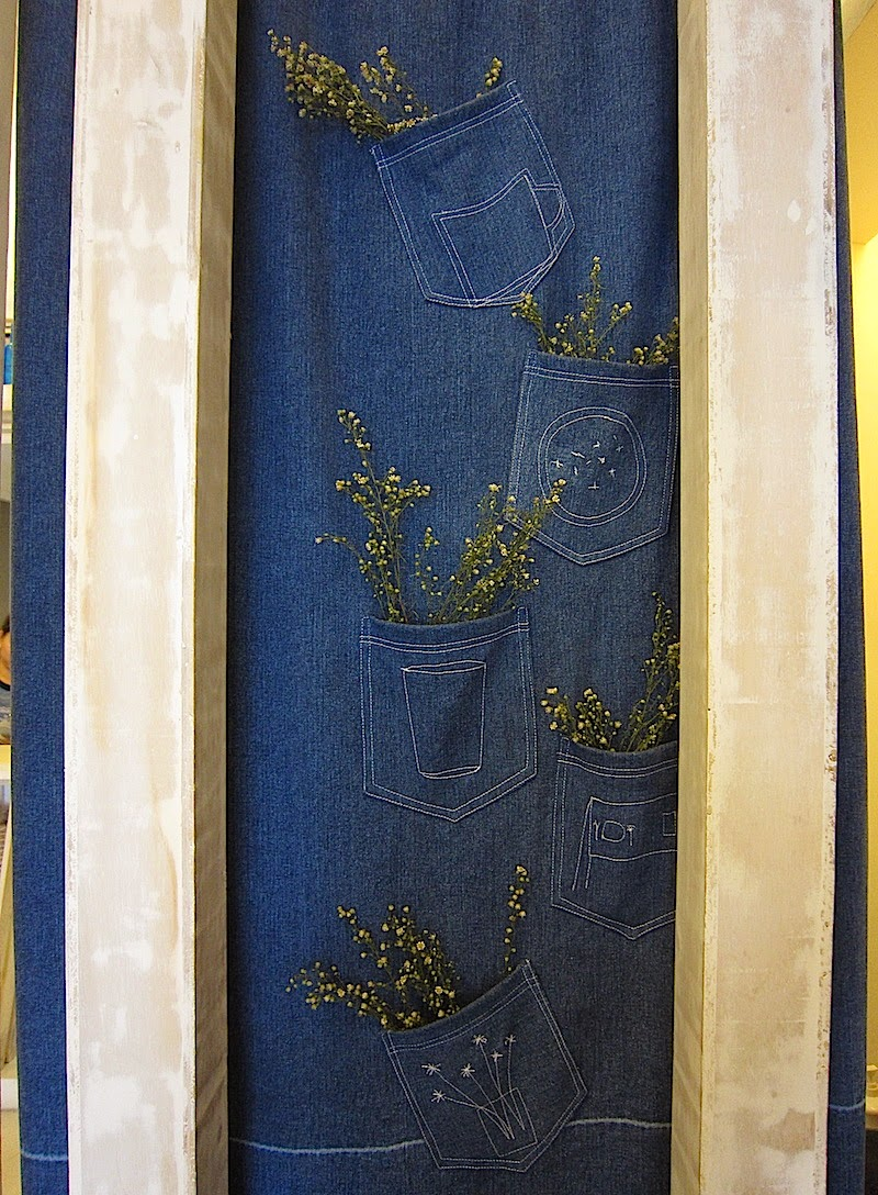 denim curtain with dried flowers