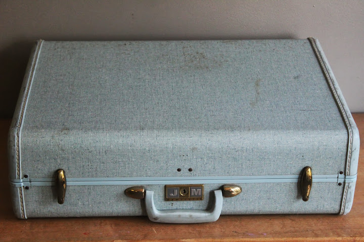 Large blue suitcase available for rent from www.momentarilyyours.com, $5.