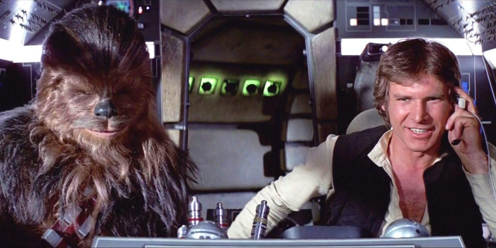 Chewbacca and Han Solo enjoying themselves in the cockpit of the Millenium Falcon.