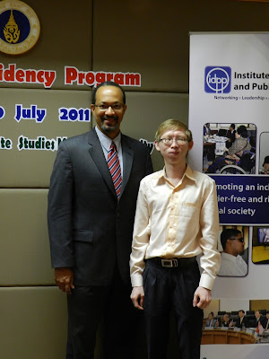 Dr. Derrick L. Cogburn, Executive Director of the IDPP, with CIDP student Mr. Khy Huy, LLM, American University, 2010, at the inaugural IDPP residency period