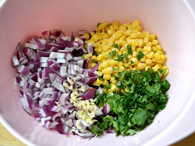 Add chopped vegetables to beans and corn
