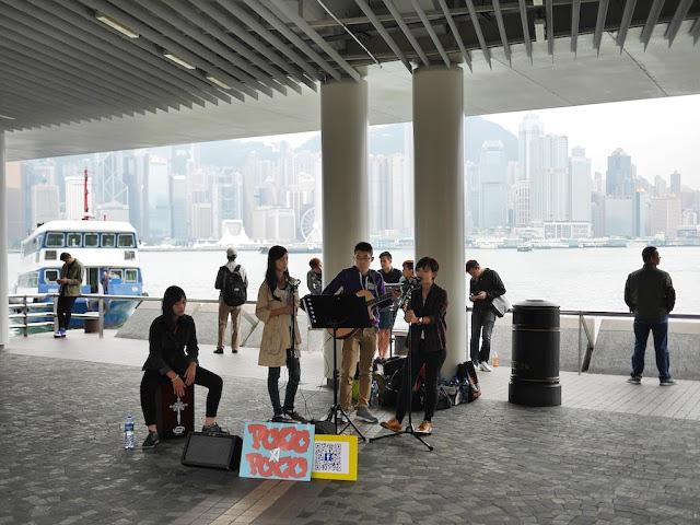 musical group Poco A Poco performing at the Kowloon Public Pier