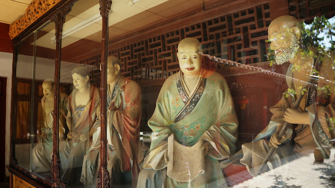 Colorful Buddhist arhats (luohans) by artist, Li Guangxiu (1880s), in the Bamboo Monastery, Kunming. (Photo courtesy of BMCL)