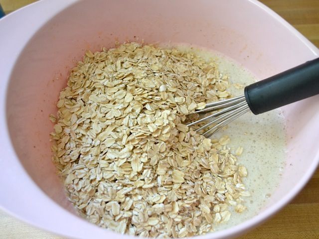 dry oats added into. mixing bowl with other ingredients