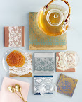 This shot ran in the September issue. We made them into pretty trivets. With lace cookies, no less!