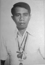 Gilbor Cmporazo with various academic medals