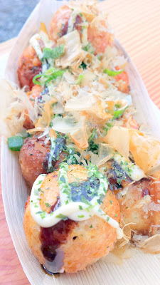 A traditional Original Takoyaki is filled with pieces of steamed octopus (Tako), and topped with lots of takoyaki sauce, Japanese mayo, nori seaweed and bonito flakes. From Buki food cart in the Tidbit Food Cart Pod on SE 28th and Division
