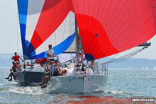 J/109 cruiser-racer one-design sailboat- sailing with spinnaker