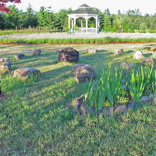 The Stone Circle sits just East of the Lavender Labyrinth.