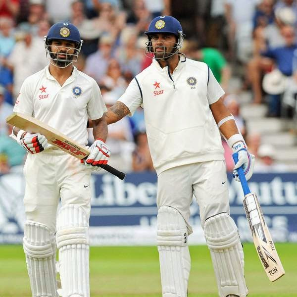 India's Murali Vijay, right, consoles Shikhar Dhawan after he was caught and bowled by England's Moeen Ali for 29 runs during day four of the first Test between England and India at Trent Bridge cricket ground, Nottingham, England, Saturday, July 12, 2014.