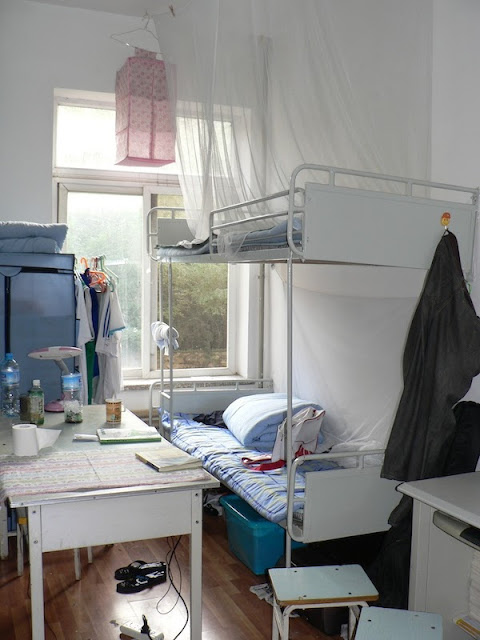 bunk bed and table in a dorm at Dalian Maritime University in China