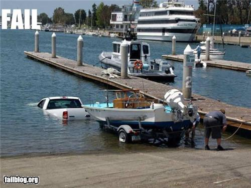 photo of a truck that pulled forward into a boat launch