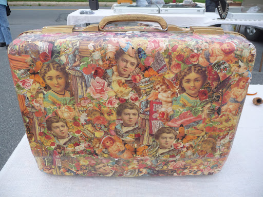 Someone put a lot of time and love into this découpage suitcase.