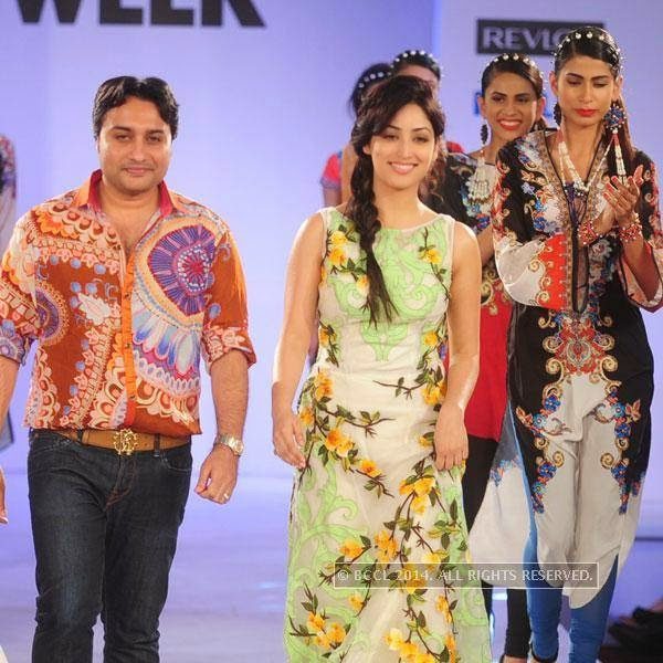 Rajdeep Ranawat and Yami Gautam walk the ramp during Jabong Online Fashion Week, held at Hotel Le Meridian, in Delhi, on July 30, 2014.