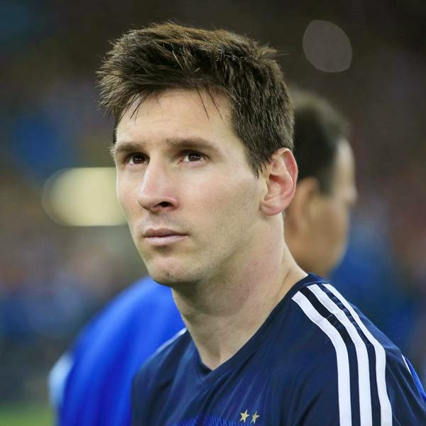 Argentina's forward and captain Lionel Messi looks on after his team's defeat in the final football match between Germany and Argentina for the FIFA World Cup at The Maracana Stadium, in Rio de Janeiro, on July 13, 2014.