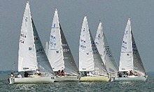 J/24 sailboats- sailing off starting line