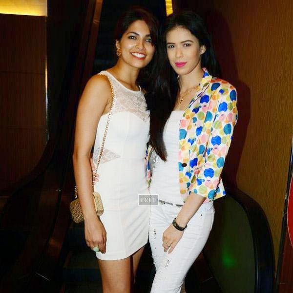 Parvathy Omanakuttan and Sucheta Sharma pose together during the premiere of Bollywood movie Pizza, held at PVR in Mumbai, on July 21, 2014.(Pic: Viral Bhayani)