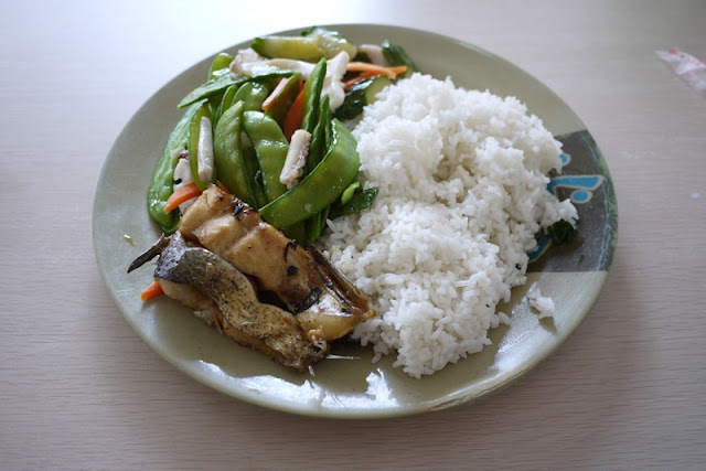 dish of squid, fish, vegetables, and rice in Zhuhai, China