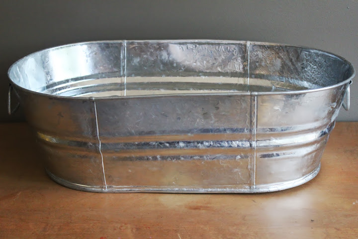 Oval metal tubs available for rent from www.momentarilyyours.com, $6 each.