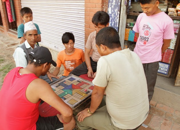 Locals enjoying a board game on a hot afternoon in Bhaktapur, Nepal