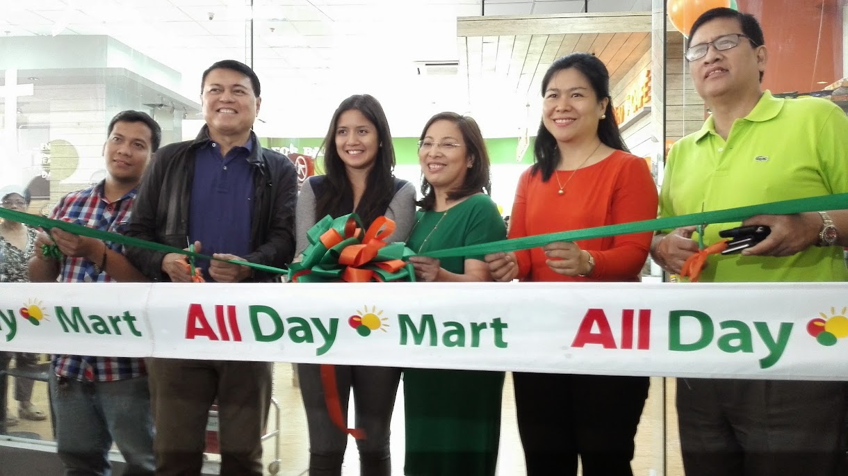 CUTTING OF THE RIBBON CEREMONY AT ALL DAY MARTS WITH CHAIRMAN MANNY VILLAR AND DAUGHTER CAMILLE VILLAR.