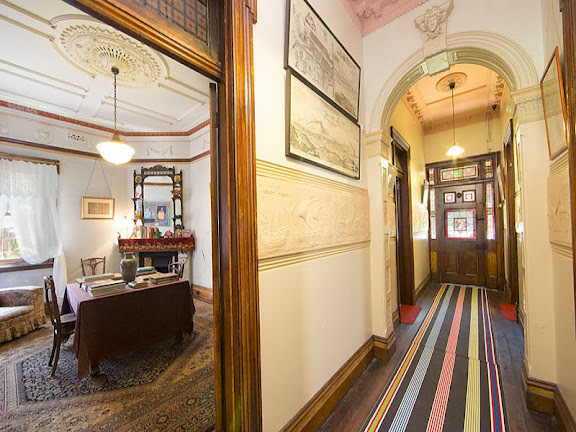 As noted above, since the glass is not Art Nouveau design, its design is typically Victorian, as are the hallway friezes and hallway arch. Notice the ventilation outlet, typical of gaslight installation.
