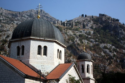 Kotor Orthodox church with mountains in the background in Montenegro