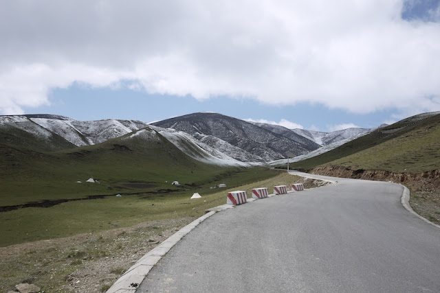 road scene with tents in Qinghai, China