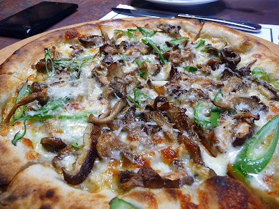 Wild Mushroom pizza with yellow foot and hedgehog mushrooms, fontina, green garlic, Oven and Shaker, Cathy Whims, Pearl District, Portland, wood fired pizza