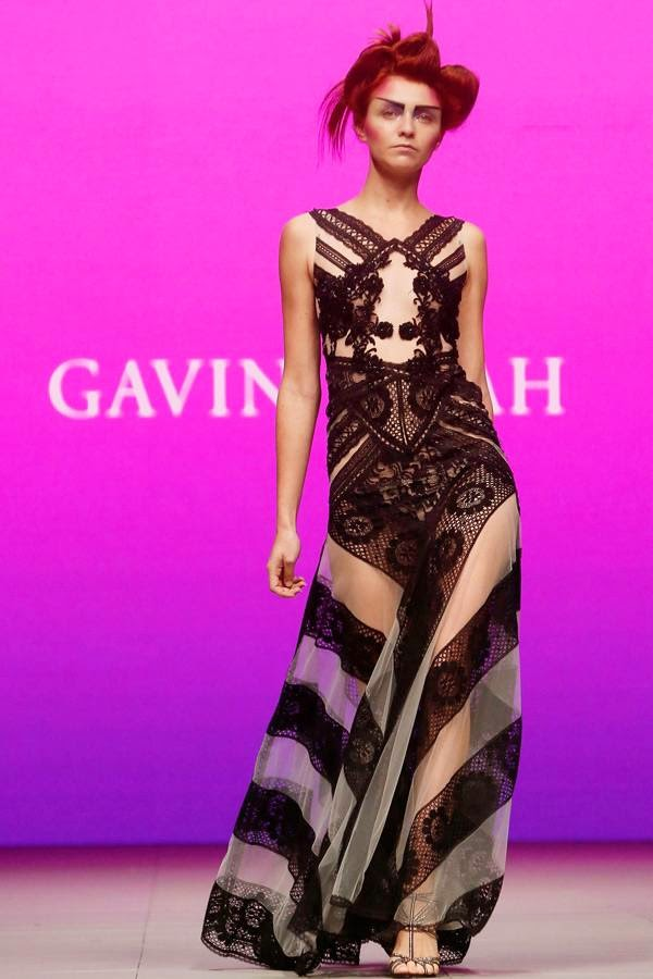 A model displays a creation of South African designer Gavin Rajah at the Cape Town Fashion Week, July 24, 2014.