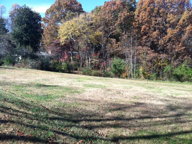 3 acre investment property in Cherokee County Georgia with 3br 2ba ranch house and 2 story barn.