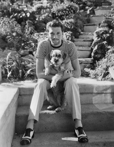 Laurence Olivier holding a dog