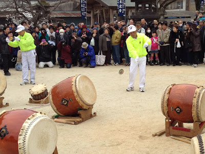 Demonstration of traditional tops near the drums