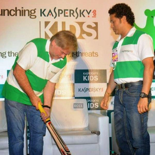 Eugene Kaspersky, Chairman & CEO, Kaspersky Lab checks out a bat as Sachin Tendulkar looks on during Kaspersky Kids awareness programme, held in Mumbai. (Pic: Viral Bhayani)