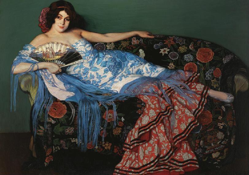 Ignacio Zuloaga - Lolita reclining in a blue Shawl