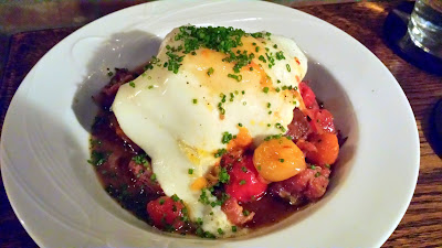 Multnomah Whiskey Library dish of Hot Brown with dark meat gravy, gruyere, belly, baked egg at $9