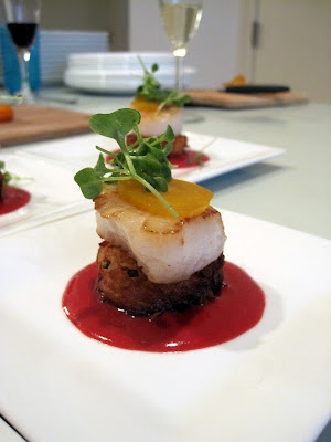 Seared scallop with beet beurre rouge, crispy potato cake, golden beet and microgreens