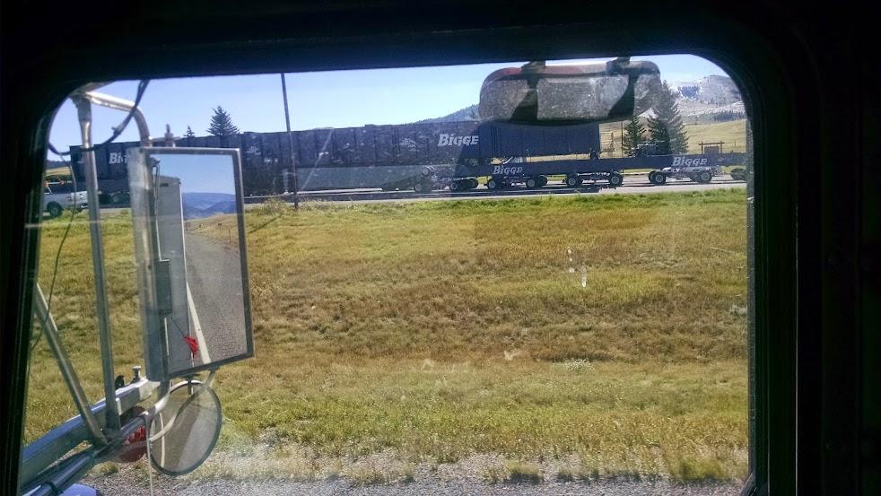 giant oversize load on huge flatbed trailers