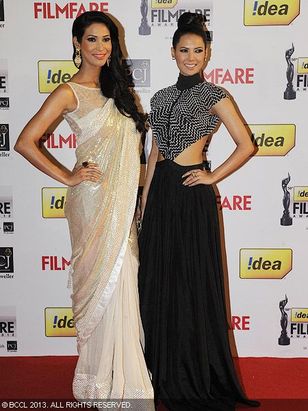 Miss India Earth 2012, Prachi Mishra, and Miss India International 2013, Rochelle Maria Rao, pose for the cameras as they walked the red carpet during the 58th Idea Filmfare Awards 2012, held at Yash Raj Films Studios in Mumbai.Click here for:<br />  58th Idea Filmfare Awards